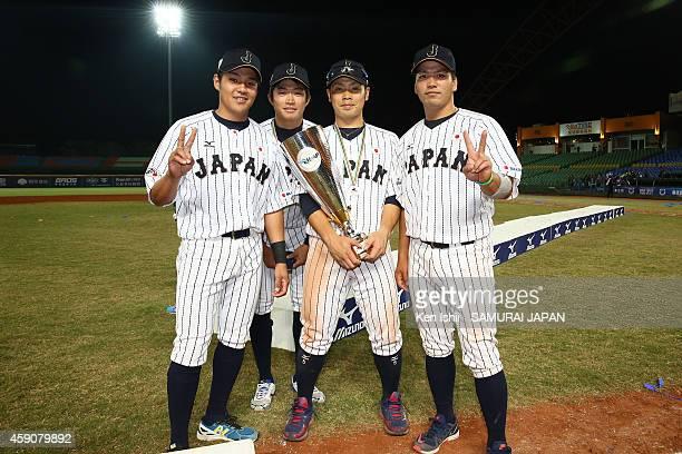 Takumi Miyoshi Kohei Sasagawa Kensuke Kondo and Shuto Takajo pose for photography after the ceremony of the IBAF 21U Baseball World Cup at Taichung...