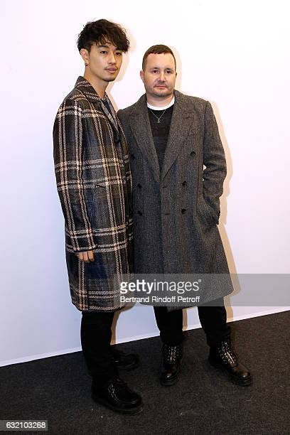 Takumi Saito and Stylist Kim Jones pose Backstage after the Louis Vuitton Menswear Fall/Winter 20172018 show as part of Paris Fashion Week Held at...