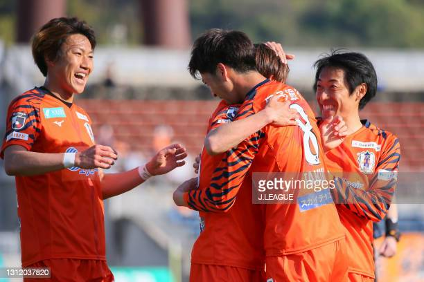 Takumu KAWAMURA of Ehime FC celebrates scoring his side's second goal with his team mates during the J.League Meiji Yasuda J2 match between Ehime FC...