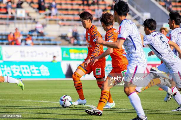 Takumu KAWAMURA of Ehime FC scores his side's second goal during the J.League Meiji Yasuda J2 match between Ehime FC and Fagiano Okayama at the...