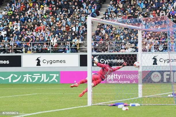 Takuo Okubo of FC Tokyo dives in vain as Riki Harakawa of Sagan Tosu scores the opening goal during the JLeague J1 match between Sagan Tosu and FC...
