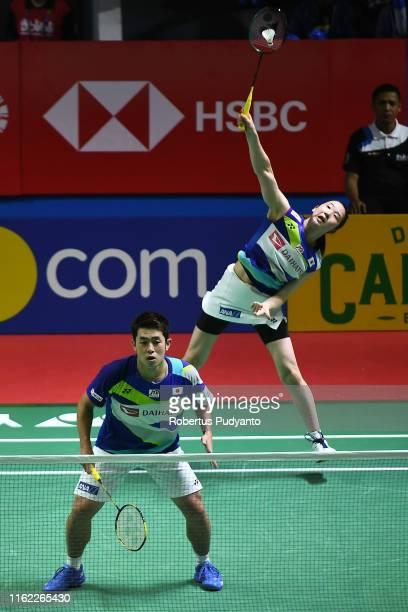 Takuro Hoki and Wakana Nagahara of Japan compete against Tang Chun Man and Tse Ying Suet of Hong Kong on day one of the Bli Bli Indonesia Open at...