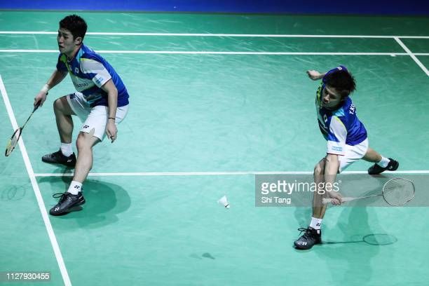 Takuro Hoki and Yogo Kobayashi of Japan compete in the Men's Doubles first round match against Zhang Nan and Liu Cheng of China during day two of the...