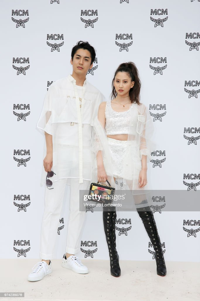 Takuro Ohno and Mayuko Kawakita attend the MCM Fashion Show Spring/Summer 2019 during the 94th Pitti Immagine Uomo on June 13, 2018 in Florence, Italy.