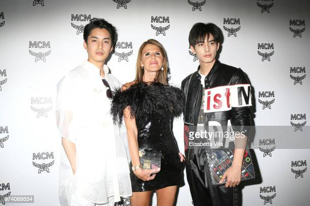 Takuro Ohno Anna Dello Russo and Song Weilong attend the MCM Fashion Show Spring/Summer 2019 during the 94th Pitti Immagine Uomo on June 13 2018 in...