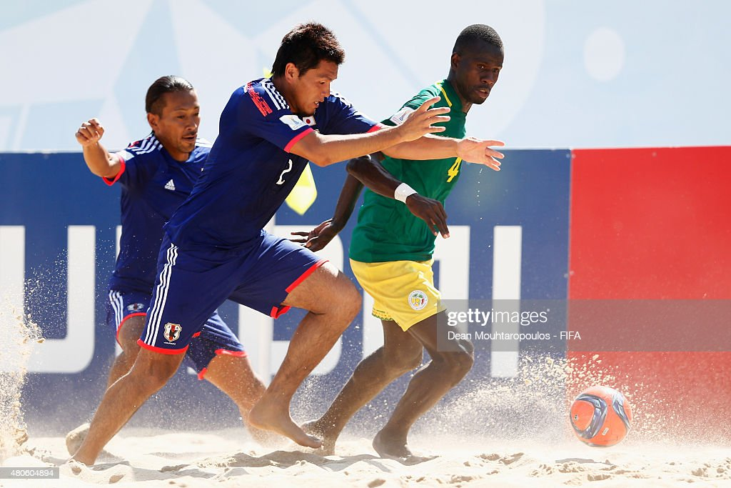 Takuya Akaguma of Japan battles for the ball with Papa Ndour of Senegal during the Group A FIFA Beach Soccer World Cup match between Japan and Senegal held at Espinho Stadium on July 13, 2015 in Espinho, Portugal.