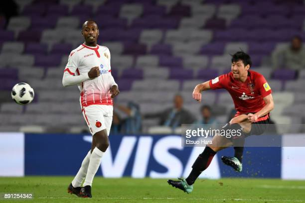 Takuya Aoki of Urawa Red Diamonds and Abdeladim Khadrouf of Wydad Casablanca compete for the ball during the FIFA Club World Cup UAE 2017 Match for...