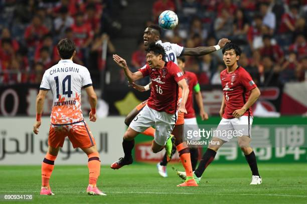 Takuya Aoki of Urawa Red Diamonds and Frederic Mendy of Jeju United FC compete for the ball during the AFC Champions League Round of 16 match between...