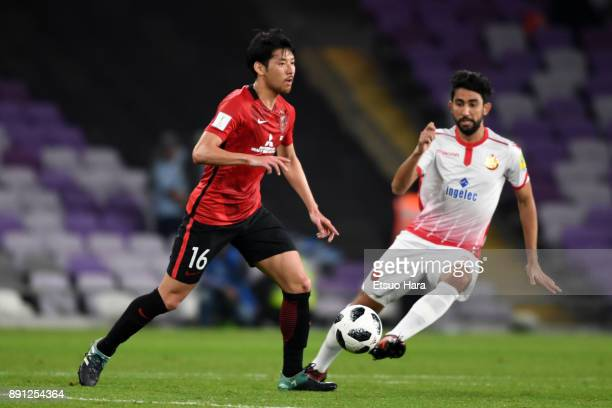 Takuya Aoki of Urawa Red Diamonds and Salaheddine Saidi of Wydad Casablanca compete for the ball during the FIFA Club World Cup UAE 2017 Match for...