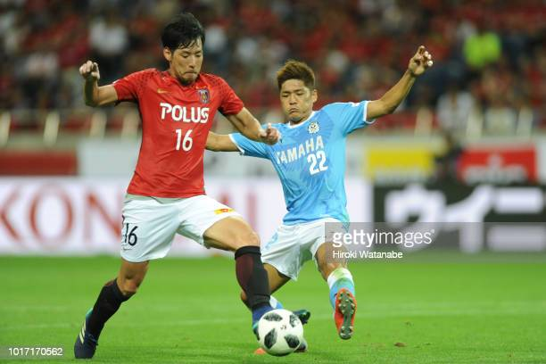 Takuya Aoki#16 of Urawa Red Diamonds and Yoshito Okubo#22 of Jubilo Iwata compete for the ball during the JLeague J1 match between Urawa Red Diamonds...