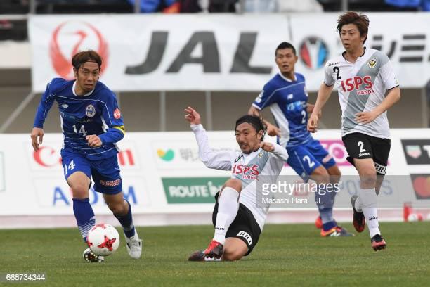Takuya Honda of Montedio Yamagata controls the ball under pressure of Tokyo Verdy defense during the JLeague J2 match between Montedio Yamagata and...
