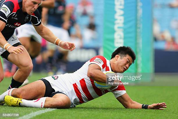 Takuya Ishibashi of Japan scores his team's second try during the Asia Rugby Championship match between Japan and Hong Kong at Prince Chichibu...