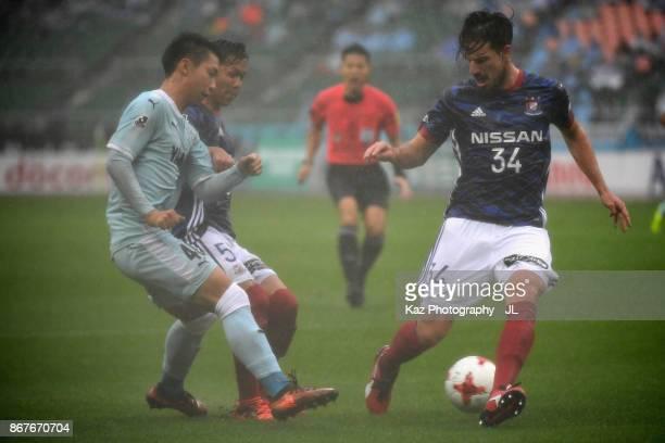 Takuya Kida and Milos Degenek of Yokohama FMarinos Hayao Kawabe of Jubilo Iwata compete for the ball during the JLeague J1 match between Jubilo Iwata...