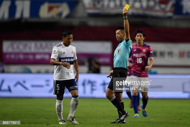 Takuya Kida of Yokohama FMarinos is shown a yellow card by referee Akihiko Ikeuchi during the JLeague match between Vissel Kobe and Yokohama FMarinos...