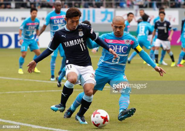 Takuya Matsuura of Jubilo Iwata and Yutaka Yoshida of Sagan Tosu compete for the ball during the JLeague J1 match between Sagan Tosu and Jubilo Iwata...
