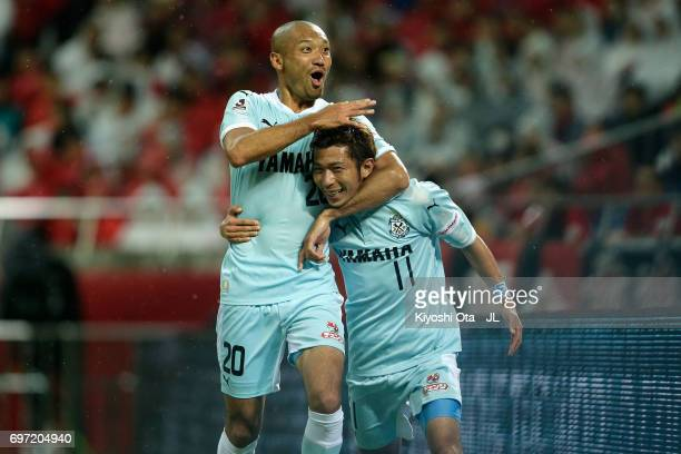 Takuya Matsuura of Jubilo Iwata celebrates scoring his side's fourth goal with his team mate Kengo Kawamata during the J.League J1 match between...