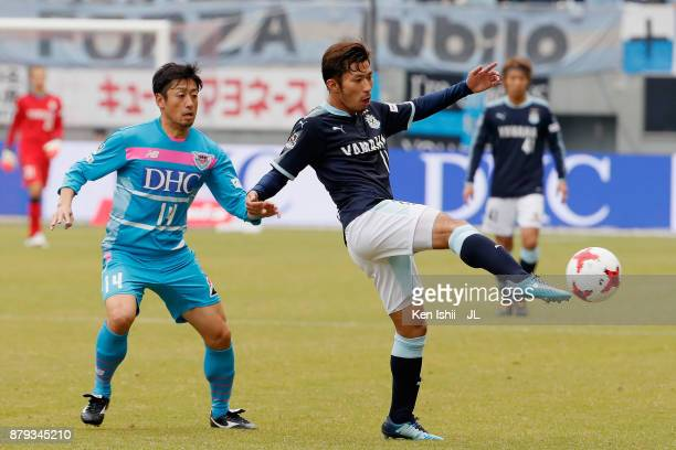 Takuya Matsuura of Jubilo Iwata controls the ball under pressure of Yoshiki Takahashi of Sagan Tosu during the JLeague J1 match between Sagan Tosu...