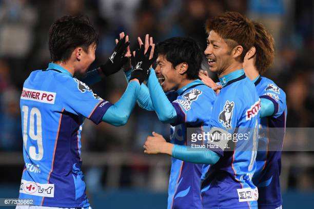 Takuya Nagata of Yokohama FC celebrates scoring his side's third goal with his team mates during the JLeague J2 match between Yokohama FC and Ehime...