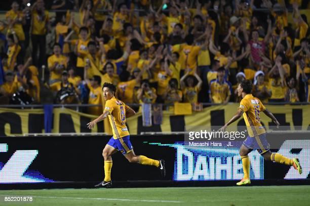 Takuya Nozawa of Vegalta Sendai celebrates scoring his side's fourth goal during the J.League J1 match between Cerezo Osaka and Vegalta Sendai at...