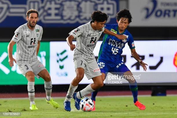 Takuya SHIGEHIRO of Avispa Fukuoka and Koki SUGIMORI of Tokushima Vortis battle for the ball during the J.League Meiji Yasuda J2 match between...