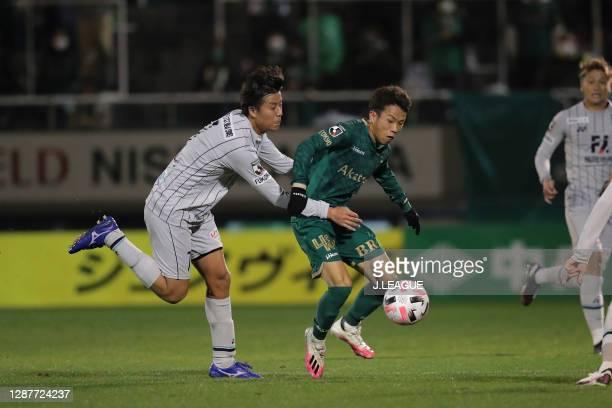 Takuya SHIGEHIRO of Avispa Fukuoka and Ryoya YAMASHITA of Tokyo Verdy battle for the ball during the J.League Meiji Yasuda J2 match between Tokyo...