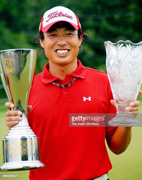 Takuya Taniguchi of Japan poses for photographs with trophies after winning the Sun Chlorella Classic at Otaru Country Club on August 3 2008 in Otaru...