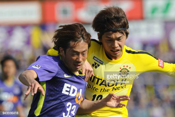 Takuya Wada of Sanfrecce Hiroshima and Yusuke Segawa of Kashiwa Reysol compete for the ball during the JLeague J1 match between Kashiwa Reysol and...