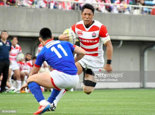 Takuya Yamasawa of Japan takes on Chang Yong Heung of South Korea during the Asia Rugby Championship match between Japan and South Korea at Prince...