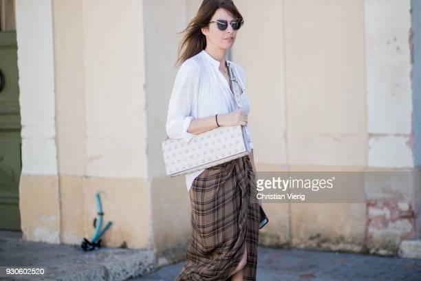 Tal Albalansi wearing brown plaid skirt white blouse is seen during Tel Aviv Fashion Week on March 11 2018 in Tel Aviv Israel