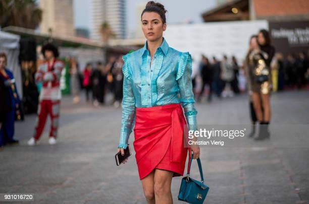 Tal Albalansi wearing red skirt blue blouse bag is seen during Tel Aviv Fashion Week on March 12 2018 in Tel Aviv Israel