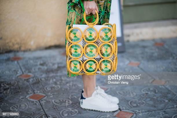 Tal Albalansi wearing yellow green bag and dress is seen during Tel Aviv Fashion Week on March 13 2018 in Tel Aviv Israel