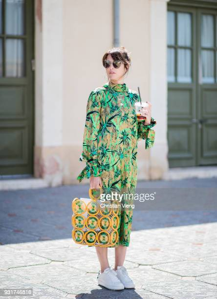 Tal Albalansi wearing yellow green bag and dress is seen during Tel Aviv Fashion Week on March 13 2018 in Tel Aviv Israel