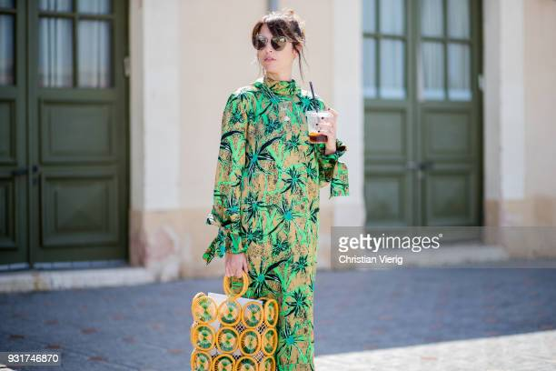 Tal Albalansi wearing yellow green bag and dress is seen during Tel Aviv Fashion Week on March 13, 2018 in Tel Aviv, Israel.