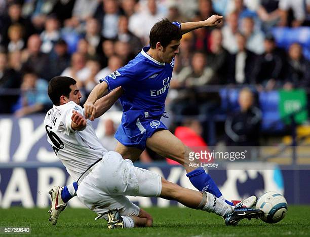 Tal Ben Haim of Bolton Wanderers tackles Joe Cole of Chelsea during the Barclays Premiership match between Bolton Wanderers and Chelsea at the Reebok...