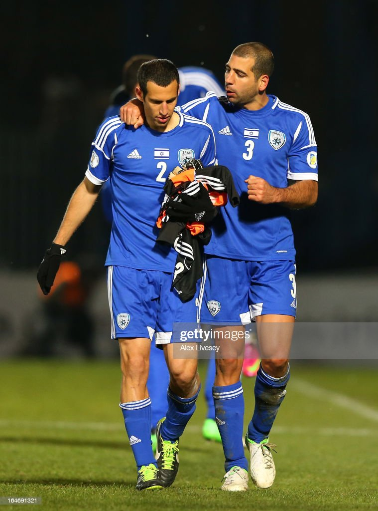 Tal Ben Haim of Israel celebrates with Yuval Shpungin after the FIFA 2014 World Cup Group F Qualifier match between Northern Ireland and Israel at Windsor Park on March 26, 2013 in Belfast, Northern Ireland.