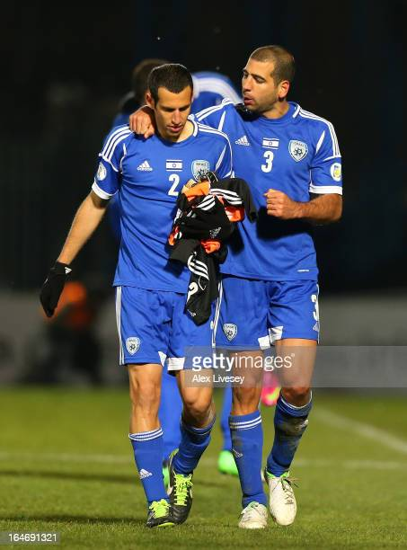 Tal Ben Haim of Israel celebrates with Yuval Shpungin after the FIFA 2014 World Cup Group F Qualifier match between Northern Ireland and Israel at...