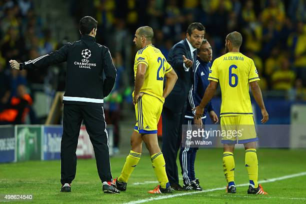 Tal Ben Haim of Maccabi TelAviv leaves the field after being sent off by referee Alberto Undiano Mallenco for a late challenge on Diego Costa of...