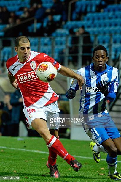 Tal Ben Haim of Standard and Mushaga Bakenga pictured during the Europa League match between Esbjerg and Standard de Liege on November 28 2013 in...