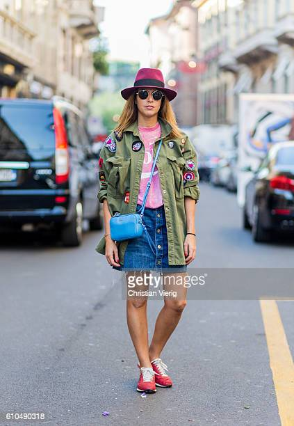 Tal Farber wearing a hat Coach bag and military jacket and denim mini skirt outside during Milan Fashion Week Spring/Summer 2017 on September 25 2016...