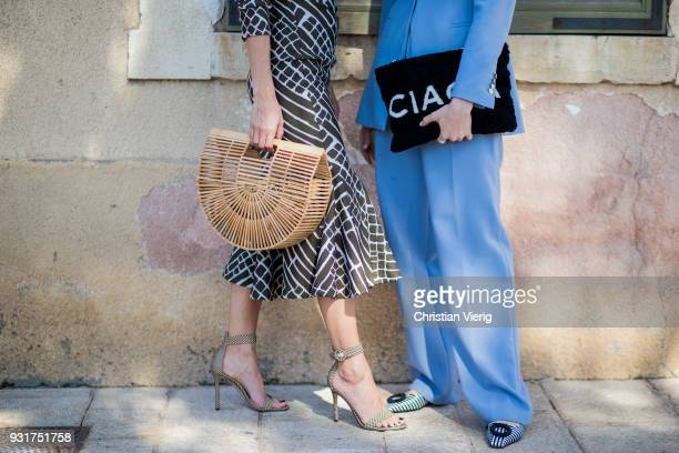 Tal Noy wearing dress and Cult Gaia bag and Romy Spector wearing blue Zara suit Celine sunglasses statement earrings Balenciaga clutch is seen during...