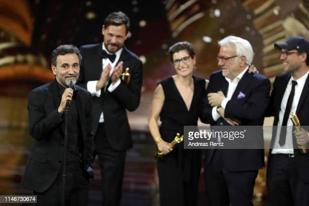 Talal Derki speaks on behalf of the team of the best documentary award winners on stage during the Lola German Film Award show at Palais am Funkturm...