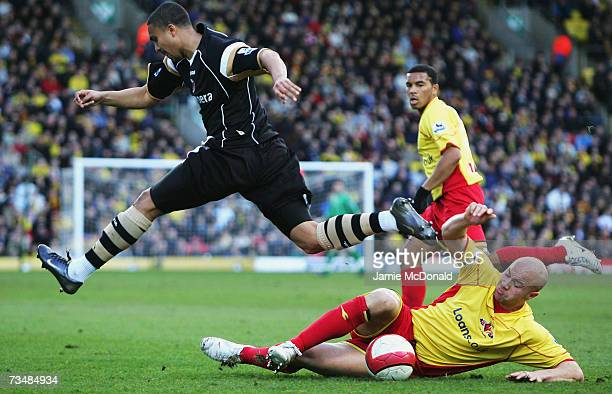 Talal El Karkouri of Charlton is tackled by Gavin Mahon of Watford during the Barclays Premiership match between Watford and Charlton Athletic on...