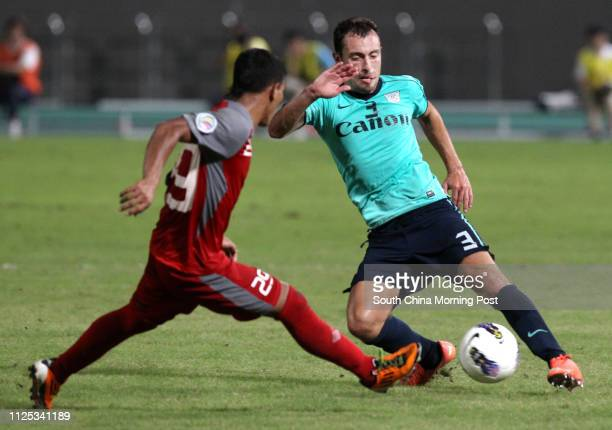 Talaohu Abudlmushafry of Arema Indonesia struggles with Daniel Cancela Rodriguez of Kitchee during an AFC Cup 2012 Round of 16 match in Tseung Kwan O...