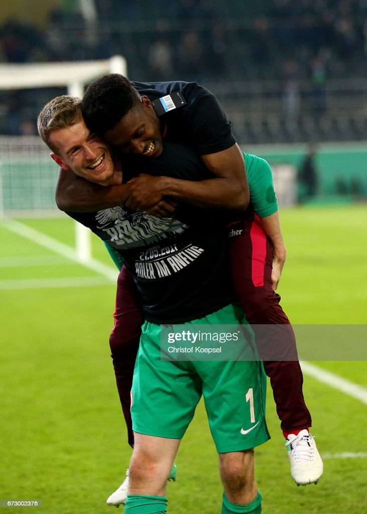 Talb Tawatha of Frankfurt celebrate victory with team mate Lukas Hradecky after penalty shoot out during the DFB Cup semi final match between Borussia Moenchengladbach and Eintracht Frankfurt at Borussia-Park on April 25, 2017 in Moenchengladbach, Germany.