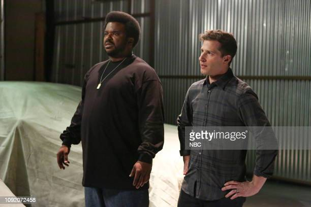 NINE A Tale of Two Bandits Episode 606 Pictured Craig Robinson as Doug Judy Andy Samberg as Jake Peralta