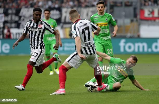 Taleb Tawatha of Frankfurt and Ante Rebic of Frankfurt and Tony Jantschke of Mönchengladbach battle for the ball during the Bundesliga Match between...