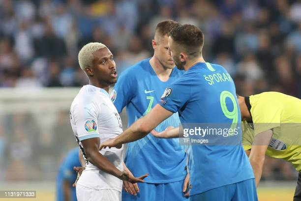 Taleb Tawatha of Israel speaks with Andraz Sporar of Slovenia during the 2020 UEFA European Championships group G qualifying match between Israel and...