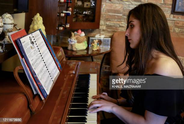 Taleen Hindeleh 20yearold daughter of a Jordanian singer and prizewinner of a culture ministry talent contest plays the piano at home in the capital...
