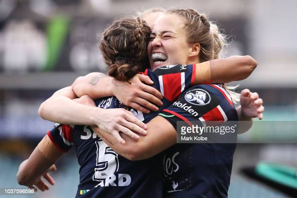 Taleena Simon and Isabelle Kelly of the Roosters celebrate Simon scoring a try during the round three WNRL match between the Sydney Roosters and the...