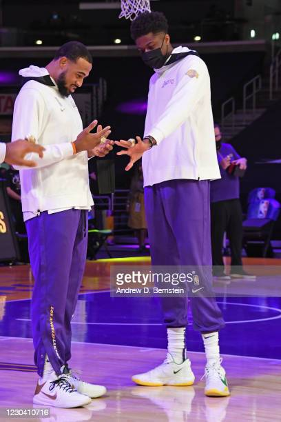 Talen Horton-Tucker and Kostas Antetokounmpo of the Los Angeles Lakers react as they get their 2019-20 NBA Championship ring during the ring ceremony...